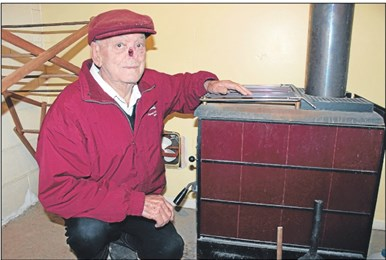 Burning need: Ted Bastable relies on his woodburner to heat his home and water.